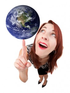 Smiling Woman Balancing Earth on Finger